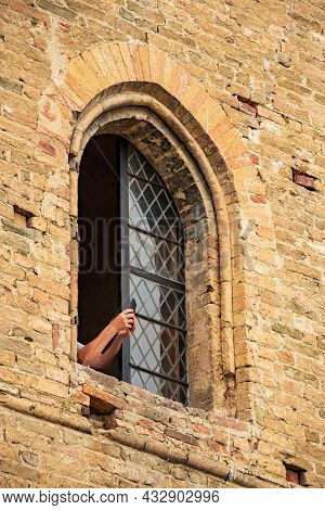 Tourist Taking Photo From A Window Of Medieval Castle Of Serralunga D'alba, Piemonte, Langhe Wine Di