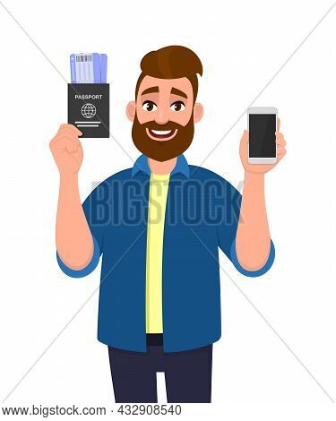 Hipster Young Man Showing Passport With Tickets And Blank Screen Phone. Trendy Bearded Person Holdin