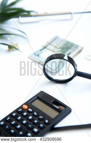 Calculator, Magnifier, Paper Money On White Background