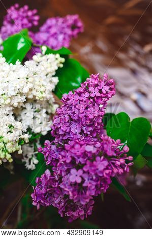 Bouquet Of White And Purple Lilacs On A Background Of Embossed Glass