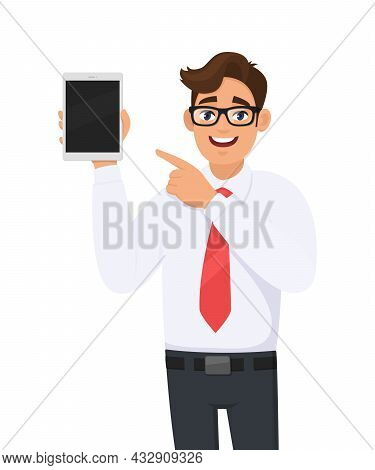Happy Businessman Showing New Tablet Computer And Pointing Finger. Person Holding Digital Tab. Male