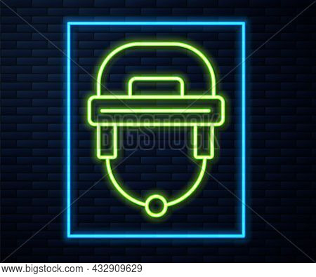 Glowing Neon Line Hockey Helmet Icon Isolated On Brick Wall Background. Vector