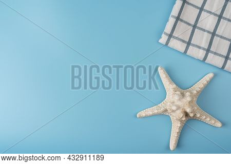 Travel Background. Starfishes On A Blue Background, Starfish With Checkered Towel, Sea Concept With