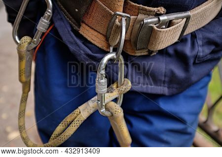 Man With Safety Equipment At Work In The Heights, Safety Body Construction. Working At Height Equipm