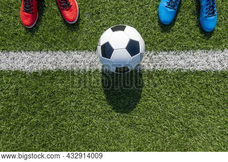 Soccer Football Background. Soccer Ball And Two Pair Of Football Sports Shoes On Artificial Turf Soc