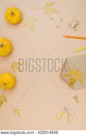 Autumn Composition With Small Yellow Pumpkins, Fallen Maple Leaves, Envelope, Pen, Pencils, Clips An