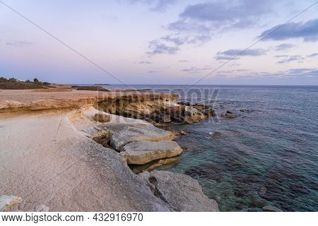 Rocky Coast And Waves Of The Mediterranean Sea Off Coast Of Cyprus Near The City Of Paphos In Summer