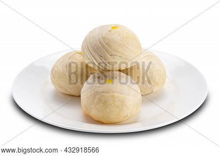 Pile Of Chinese Pastry Or Moon Cake Filled With Mashed Mung Bean And Salted Egg Yolk In White Cerami