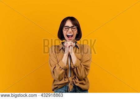 Overjoyed Woman Shouting Omg, Clasping Her Hands Together, Shouting Wow With Open Mouth Over Huge Su