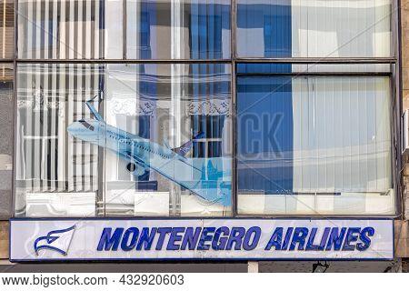 Belgrade, Serbia - August 08, 2021: Montenegro Airlines Old Sign At Office Building In Belgrade.