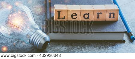 Cube Letter Word Of Learn With Textbook And Light Bulb. Self Learning Or Education Knowledge And Bus