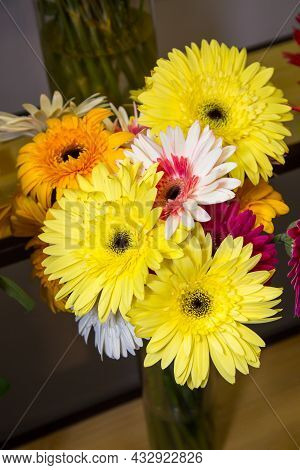 A Bouquet Of Flowers Of Gerbera (lat. Gerbera) Yellow And White And Aster (lat. Aster) On The Shelve