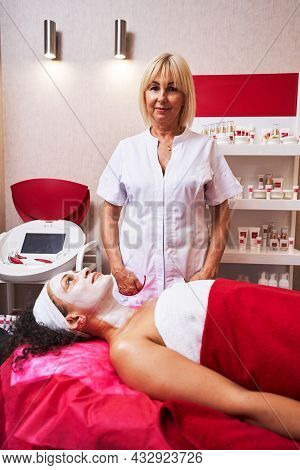 Positive Delighted Cosmetologist Working In Beauty Studio