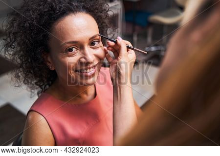 Positive Delighted Female Looking Straight At Camera