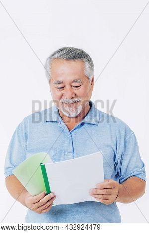 Senior Male , Elderly Man With Glasses Is Reading A Novel Isolated On White Background - Lifestyle S