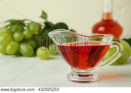 Concept Of Grape Vinegar On White Textured Table
