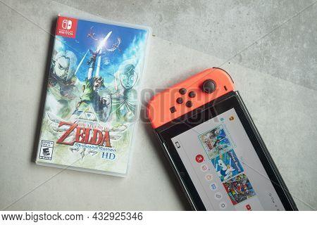 Samut Prakan, Thailand - August 28, 2021 : Nintendo Switch With A Box Of The Legend Of Zelda: Skywar