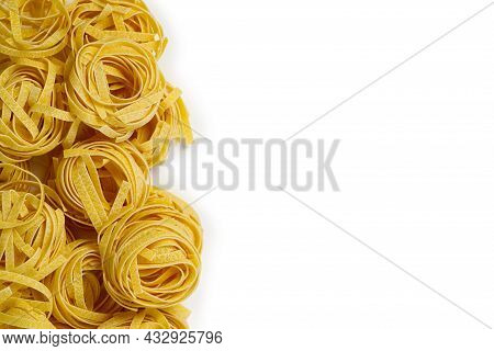 Fettuccine Italian Pasta Isolated On White Background. Raw Tagliatelle Nests Isolated On White Backg