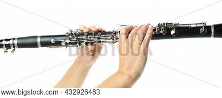 Female Hands Hold Clarinet, Isolated On White Background