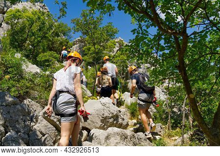 Hiking - Adventure - Healthy Lifestyle. Group Of Hikers Walks On Mountain Rural Landscape. Group Of