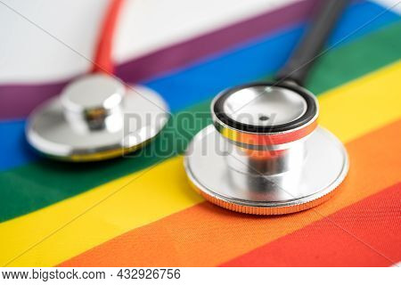Red Stethoscope On Rainbow Flag Background, Symbol Of Lgbt Pride Month Celebrate Annual In June Soci