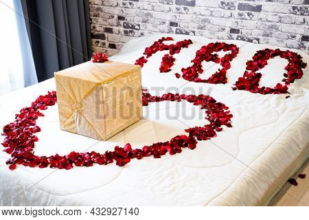Happy Birthday Present ,a Big Gift Gold Box Packed And Decorated On Bed ,put Inside Rose Heart In Be