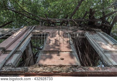 Old Wooden Windows On The Old Wall Of Abandoned Ancient Building Was Left To Deteriorate Over Time.