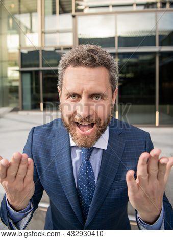 Cheerful Emotional Bearded Businessman In Formal Suit Gesturing, Emotional