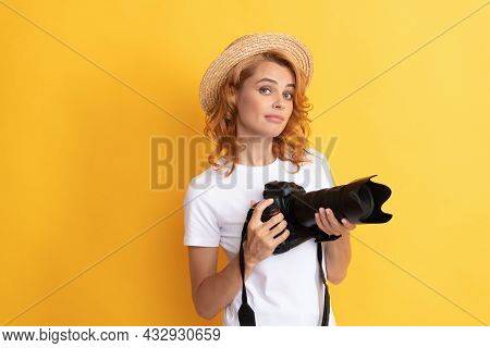 Young Redhead Woman Photographer With Camera In Straw Hat Making Photo, Photoshoot