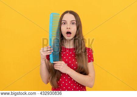 Amazed Child Long Hair Hold Hairbrush On Yellow Background, Hairdresser