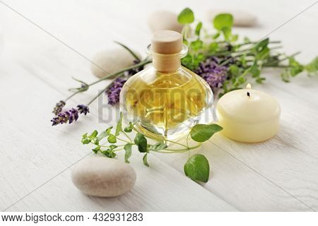 SPA still life. lavender flowers, pebbles, aromatherapy candle, essential oil