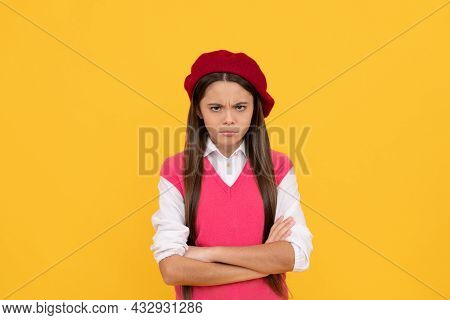 Unhappy Teen School Girl In French Beret On Yellow Background, Seriousness