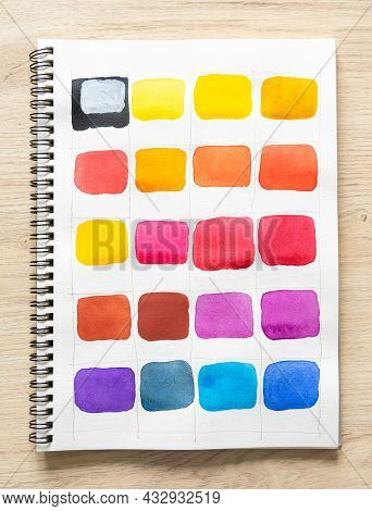 Watercolor Spot Paint On White Notebook Paper With Wood Background. Colorful Shade Collection On Whi