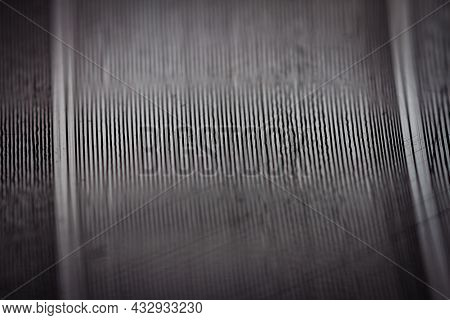 Macro Shot Of Black Vinyl Record Showing Scratches. Surface Of An Old Vinyl Record. Shallow Deph Of