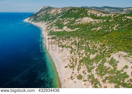 Coastline With Sea And Highest Cliff On Coastline. Summer Day On Sea. Aerial View