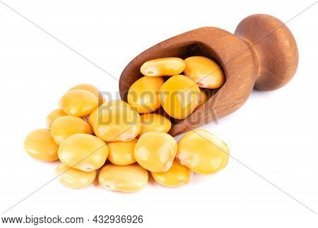 Pickled Yellow Lupine Beans In Wooden Scoop, Isolated On White Background. Tournus, Preserved Lupinu