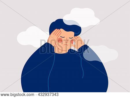 A Sad Young Man Has A Clouded Mind On Blue Background. A Depressed Teenager Boy Suffers From Tempora
