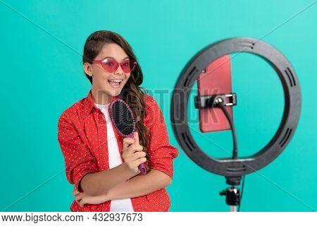 Happy Kid Presenting Hairbrush In Sunglasses Blogging Online, Advertisement.