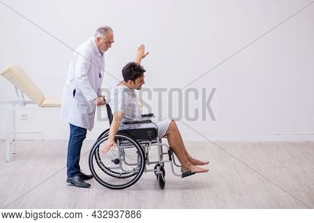 Old male doctor psychiatrist examining young disabled patient