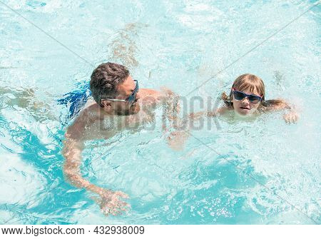 Happy Family Of Daddy And Kid Having Fun In Summer Swimming Pool, Swim