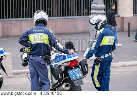 Moscow - September 12, 2021: Highway patrol officers on police motorcycles are on duty in city