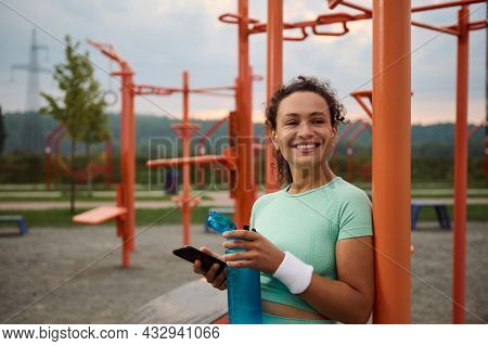 Charming Sporty Mature African American Woman Enjoying The Rest After Morning Workout, Smiling With