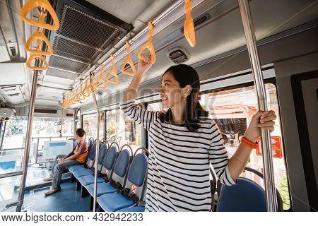 Asian Indonesian Or Malay Woaman In Public Transport