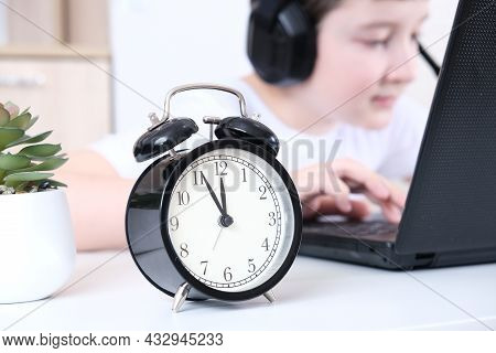 A Boy Homeschooler With Headphones Sitting At A Laptop And Learning, Online Education Concept, The L
