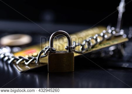 Credit Card Security, Safe Trading. Credit Card Closed With A Padlock And Chain