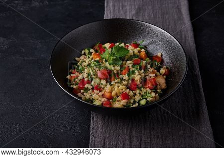 Close Up Lebanese Or Syrian Traditional Salad Tabbouleh Made Of Bulgur Or Couscous, Poultry Meat, Pa