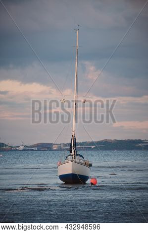 Yacht Standing On The Shallows In The Background Of The Firth Of Forth At Sunset, Scotland
