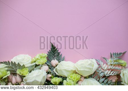 Arrangement Of Delicate Pink Spray Roses And White Roses And Flowers On A Pink Background. High Qual