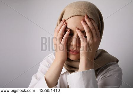Close-up Of Arabian Young Woman Wearing Hijab, Having Issues. Stress, Problems.