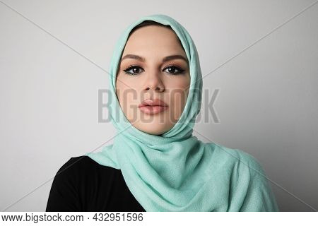 Portrait Of Arabian Young Woman Wearing Colourful Hijab, Isolated On White Wall.